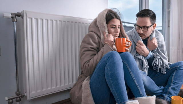 cold couple next to heater