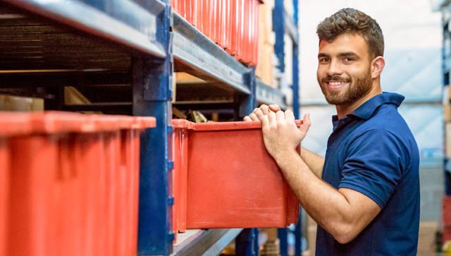 Young man working in a warehouse.