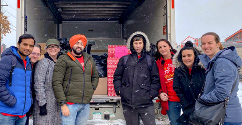 More Cash Money volunteers in front of delivery truck in the snow